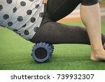 woman using a foam roll on her... | Shutterstock . vector #739932307
