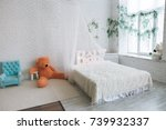 A White Bed With A Canopy And...