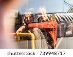 smiling couple looking away... | Shutterstock . vector #739948717