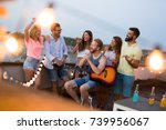 group of happy friends having... | Shutterstock . vector #739956067