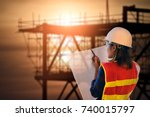 female site engineer with white ... | Shutterstock . vector #740015797