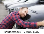a happy young man hugging his... | Shutterstock . vector #740031607