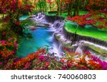 waterfall in autumn forest at... | Shutterstock . vector #740060803