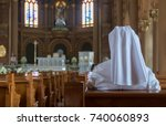 the nun sits in the church and... | Shutterstock . vector #740060893