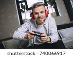 close up of a young man playing ...   Shutterstock . vector #740066917