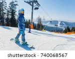 cute girl with a snowboard on... | Shutterstock . vector #740068567