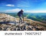 photographer work in mountain.... | Shutterstock . vector #740072917