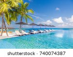 luxury poolside with sun beds... | Shutterstock . vector #740074387