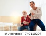 joyful relatives playing video... | Shutterstock . vector #740110207