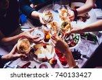 glasses of white wine seen... | Shutterstock . vector #740133427