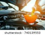 hand mechanic in repairing car... | Shutterstock . vector #740139553
