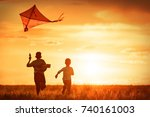 children launch a kite in the... | Shutterstock . vector #740161003