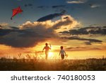 children launch a kite in the... | Shutterstock . vector #740180053