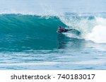 bodyboarder surfing ocean wave... | Shutterstock . vector #740183017