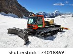 A Snow Groomer In The Swiss Alps