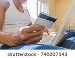 woman with computer shopping... | Shutterstock . vector #740207143