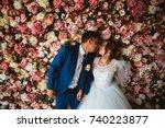 beautiful bride and groom on... | Shutterstock . vector #740223877