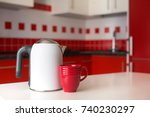 electric kettle with cup on a... | Shutterstock . vector #740230297