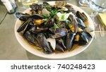 mussels with cream sauce in... | Shutterstock . vector #740248423