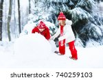 children build snowman. kids... | Shutterstock . vector #740259103
