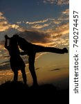 silhouette of a dancing couple   Shutterstock . vector #740274457