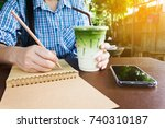 hand with cool green tea and... | Shutterstock . vector #740310187