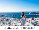 girl in white dress  looking at ... | Shutterstock . vector #740342347