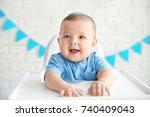 cute baby in kippah sitting on... | Shutterstock . vector #740409043