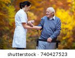 nurse measuring old patient's... | Shutterstock . vector #740427523