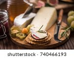 cheese crackers with camembert... | Shutterstock . vector #740466193