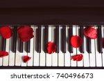 Stock photo rose petals on piano keys 740496673