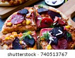 mixed pizza with beetroot ready ...