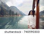 woman tourist in cozy sweater...   Shutterstock . vector #740590303