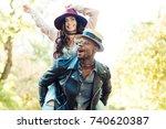 afro american boyfriend giving... | Shutterstock . vector #740620387