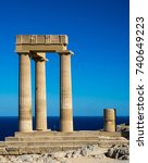 Small photo of View of ancient Temple of Athena Lindia in Acropolis of greek town of Lindos on Rhodes Island. Classic doric columns in antique architecture of Greece. Architectural landmarks of the world culture.