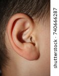 close up of kid ear | Shutterstock . vector #740666287