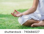 lotus position close up | Shutterstock . vector #740686027
