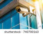 cctv security camera against... | Shutterstock . vector #740700163