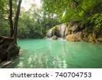 breathtaking green waterfall at ... | Shutterstock . vector #740704753