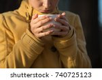 young woman holds cup of tea ... | Shutterstock . vector #740725123