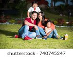 indian family sitting in lawn   ... | Shutterstock . vector #740745247