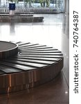 Small photo of Baggage conveyor belt at the airport terminal in close up detail