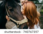 beautiful couple with horse in... | Shutterstock . vector #740767357