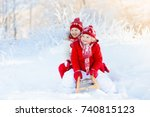 little girl and boy enjoying... | Shutterstock . vector #740815123