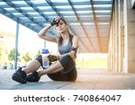 tired sporty girl with water... | Shutterstock . vector #740864047