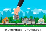 hand picks a house. suburban... | Shutterstock . vector #740906917