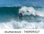 bodyboarder surfing ocean wave...   Shutterstock . vector #740909317