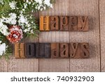 Happy Holidays Text On A Woode...