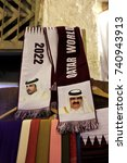 Small photo of SOUQ WAQIF, DOHA, QATAR - OCTOBER 23, 2017: World Cup 2022 scarves on sale in the souq, with the portraits of the two most recent rulers