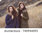 two beautiful woman in fashion... | Shutterstock . vector #740944093